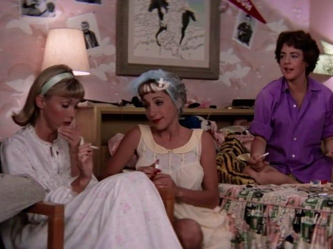 the pink ladies sitting in frenchie's bedroom