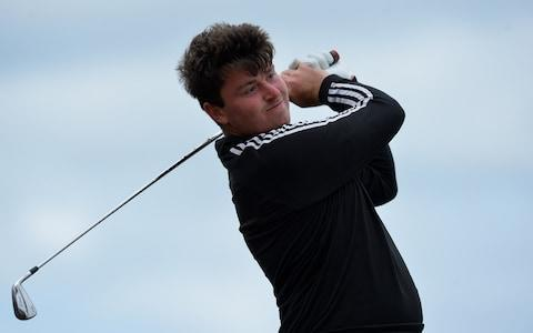 """Ernie Els's nephew is just three steps away from a place at the Masters, the major which famously eluded the graceful South African. Jovan Rebula upheld family honour by progressing to the quarter-finals of the Amateur Championship at Royal Aberdeen. Rebula, who is the son of Els's sister, Carina, survived a tense encounter with Yorkshire's Ben Hutchinson before prevailing on the 18th. This morning, Rebula, who is in college in Alabama, plays Tom Sloman and once again the confident 21-year-old will feed off the influence of the Big Easy, as he targets all the perks that come with this historic trophy, including berths at Augusta and at next month's Open Championship. """"He's done a lot for me over my career,"""" Rebula said. """"We've got a very good relationship. It's always special to have someone like that you can talk to who's been in way bigger moments than this."""" Sloman will provide stern opposition. He was the underdog against 18-year-old South African Wilco Nienaber, who topped the strokeplay section, but the English international from Somerset battled back from one-down with five to play to prevail on the 18th. Tom Sloman is the man standing in Rebula's way Credit: getty images Should Sloman come through the Rebula test then he could face Mitch Waite - another West Countryman playing out of Filton Golf Club in Bristol - in the afternoon semi-final. Waite was four up with four to play against Germany's Timo Vahlenkamp and seemed to be cruising into a showdown with the Swede Christoffer Palsson. But Waite saw his lead disappear and was taken to sudden death. However, a par on the first saw a very relieved Waite scrape through. There are also three Irishmen still standing in this marathon tournament, which featured 288 players going out in the 36-hole strokeplay stages, with 64 players plus ties going through to the knockout matchplay. Conor Purcell, Robin Dawson and John Murphy are in the last eight, hoping to emulate Alan Dunbar, the only Irish winner in the last 17"""