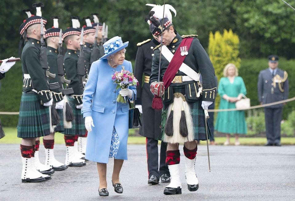 <p>The queen walks alongside an armed forces member throughout her inspection of the Argyll and Sutherland Highlanders.</p>