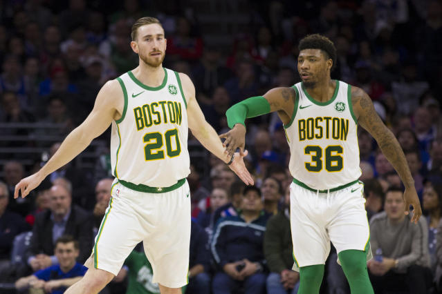 PHILADELPHIA, PA - FEBRUARY 12: Gordon Hayward #20 of the Boston Celtics celebrates with Marcus Smart #36 against the Philadelphia 76ers in the second quarter at the Wells Fargo Center on February 12, 2019 in Philadelphia, Pennsylvania. (Photo by Mitchell Leff/Getty Images)