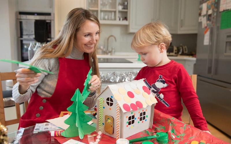 Anna Tyzack making a cardboard gingerbread house with her son Alfie - Copyright ©Heathcliff O'Malley , All Rights Reserved, not to be published in any format without p