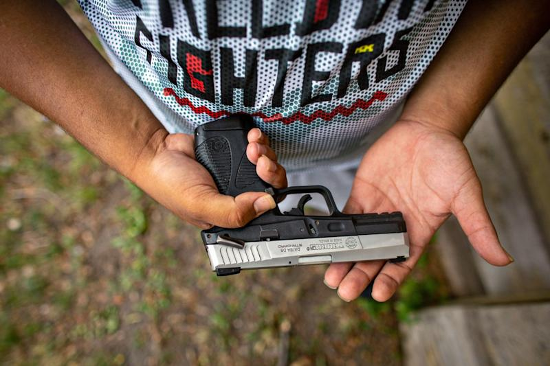 Romeal Taylor, a member of the Minnesota Freedom Fighters, carries a legally registered handgun.