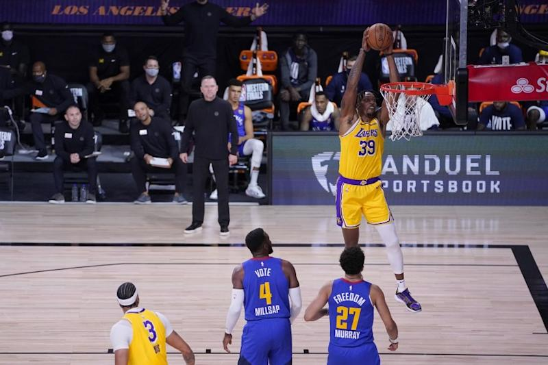 Lakers center Dwight Howard prepares to dunk after receiving an alley-oop pass during Game 1 on Sept. 18, 2020.