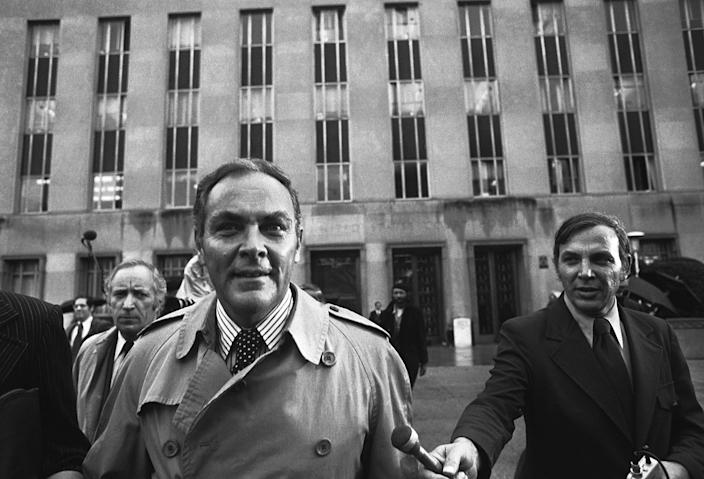"""<p>President Nixon's chief of staff, Alexander Haig, leaves U.S. District Court, Dec. 6, 1973, in Washington, after telling Judge John Sirica that Nixon was """"very, very disturbed"""" at hearing three weeks earlier that 18 minutes of a subpoenaed Watergate tape had been erased. Behind Haig at left is Leonard Garment, a White House lawyer. (Photo: Bob Daugherty/AP) </p>"""