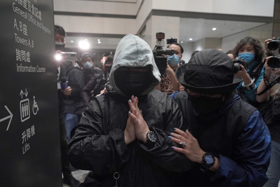 Supporters of one of the 47 pro-democracy activists react outside a court in Hong Kong Thursday, March 4, 2021. A Hong Kong court on Thursday remanded all 47 pro-democracy activists charged under a Beijing-imposed national security law in custody, ending a four-day marathon court hearing. (AP Photo/Kin Cheung)