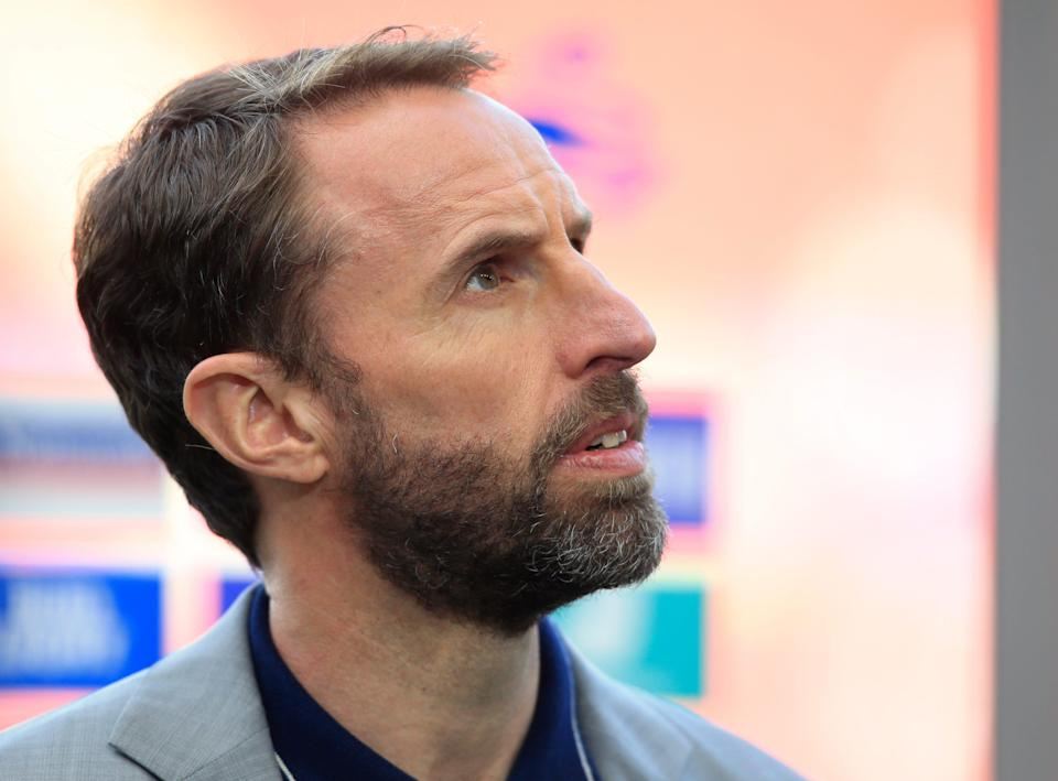 England coach Gareth Southgate stands on the side of the pitch before the international friendly soccer match between England and Austria at the Riverside stadium in Middlesbrough, England,
