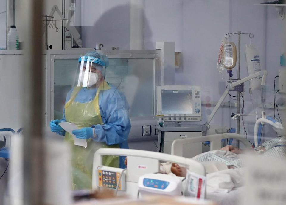 A member of the intensive care team treats Covid-19 patients at Craigavon Area hospital in Co Armagh, Northern Ireland.