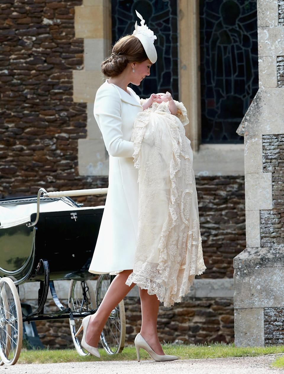 Princess Charlotte also wore the Honiton replica gown for her christening on 5 July 2015 at the Church of St Mary Magdalene [Photo: Getty]