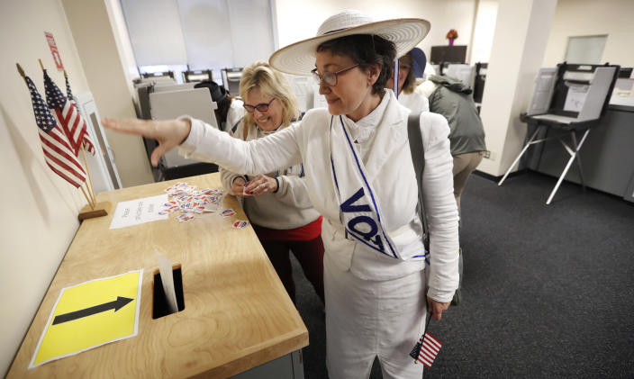 <p>Jodi Stanfield, of Windsor Heights, Iowa, drops her ballot in the ballot box at the Polk County Election office on the first day of early voting for the Iowa general election, Monday, Oct. 8, 2018, in Des Moines, Iowa. (Photo: Charlie Neibergall/AP) </p>