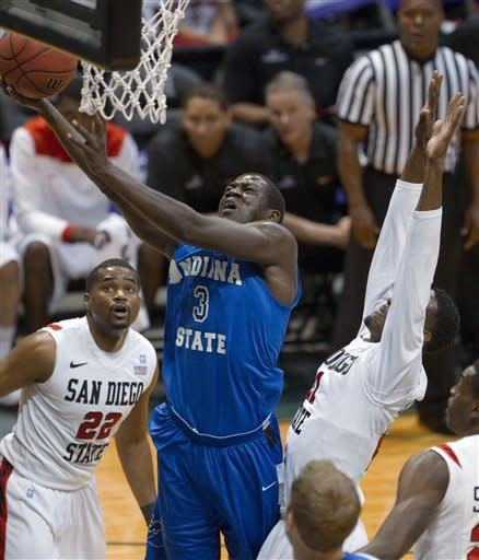 Indiana State forward Manny Arop (3) moves between San Diego State's Chase Tapley (22) and his Jamaal Franklin, right, for a layup in the first half of an NCAA college basketball game in the Diamond Head Classic, Sunday, Dec. 23, 2012, in Honolulu. (AP Photo/Eugene Tanner)