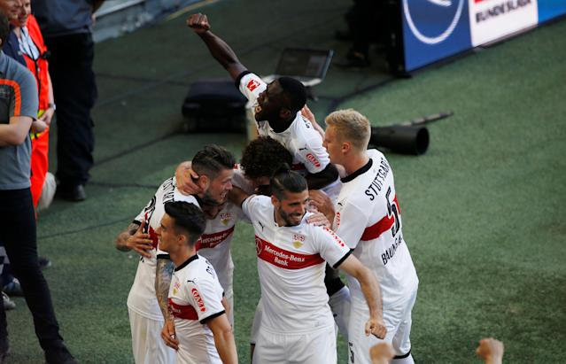 Soccer Football - Bundesliga - Bayern Munich v VfB Stuttgart - Allianz Arena, Munich, Germany - May 12, 2018 Stuttgart's Daniel Ginczek celebrates scoring their fourth goal with team mates REUTERS/Michaela Rehle DFL RULES TO LIMIT THE ONLINE USAGE DURING MATCH TIME TO 15 PICTURES PER GAME. IMAGE SEQUENCES TO SIMULATE VIDEO IS NOT ALLOWED AT ANY TIME. FOR FURTHER QUERIES PLEASE CONTACT DFL DIRECTLY AT + 49 69 650050