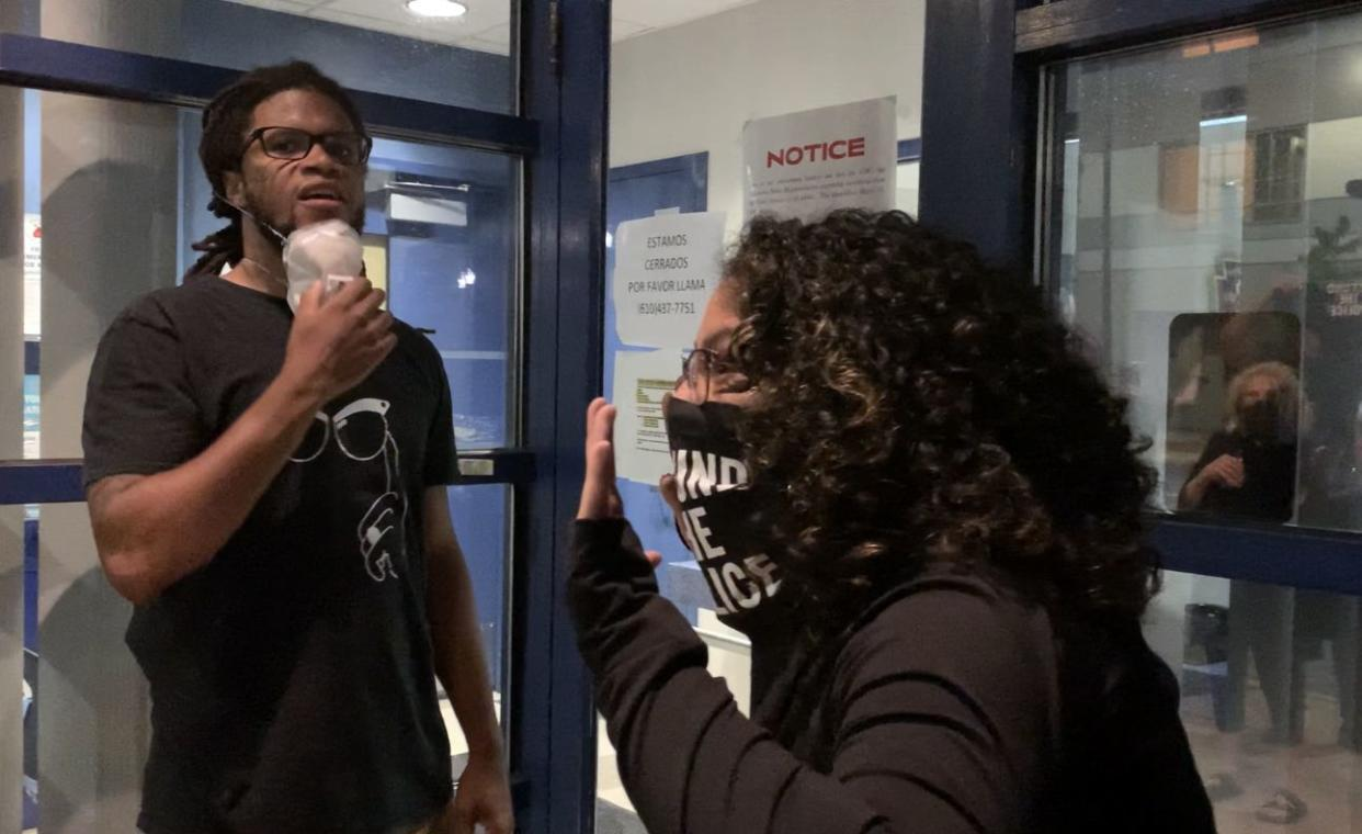Rodney Bushe, of POWER Lehigh Valley, knocks on the door to Allentown Police Department's precinct at 10th and Hamilton while Meagan Llerena, of Make the Road Pennsylvania, asks,