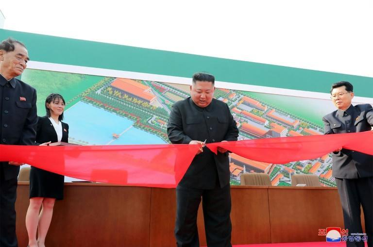 North Korea said the picture taken on May 1, showed North Korean leader Kim Jong Un (2nd R) attending a ceremony in South Pyongan Province