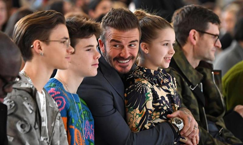 The Beckhams (Romeo, Cruz, David and Harper) on the front row for the Victoria Beckham catwalk show . Photograph: Daniel Leal-Olivas/AFP via Getty Images