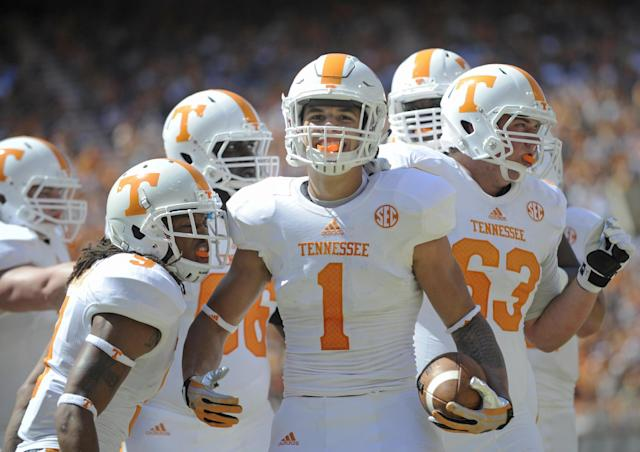 Tennessee running back Jalen Hurd (1) celebrates after scoring a touchdown during the first half of the Orange and White game at Neyland Stadium in Knoxville, Tenn., Saturday, April 12, 2014. (AP Photo/Knoxville News Sentinel, Adam Lau) (AP Photo/Knoxville News Sentinel, Adam Lau)