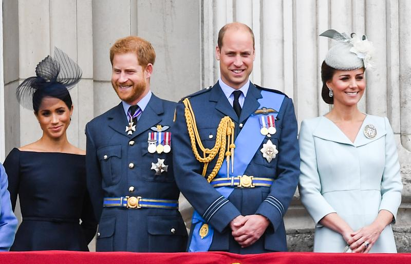 Prince William and Kate Middleton pose on Buckingham Palace balcony with Harry and Meghan Markle. Source: Getty