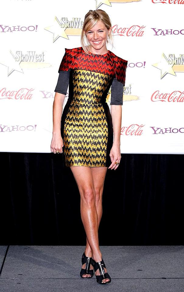 """Sienna Miller solidified her status as a style icon when she sported this super sexy Jonathan Saunders patterned mini and zippered Sergio Rossi sandals at the ShoWest Awards. Ethan Miller/<a href=""""http://www.gettyimages.com/"""" target=""""new"""">GettyImages.com</a> - April 2, 2009"""