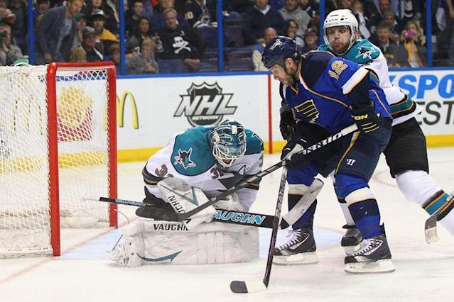 ST. LOUIS, MO - APRIL 21: Antti Niemi #31 of the San Jose Sharks makes a save against Scott Nichol #12 of the St. Louis Blues as Tommy Wingels #57 of the San Jose Sharks defends during Game Five of the Western Conference Quarterfinals during the 2012 NHL Stanley Cup Playoffs at the Scottrade Center on April 21, 2012 in St. Louis, Missouri. The Blues beat the Sharks 3-1 to advance to the Western Conference Semifinals. (Photo by Dilip Vishwanat/Getty Images)