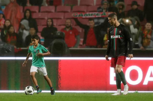 Soccer Football - International Friendly - Portugal vs Algeria - Estadio da Luz, Lisbon, Portugal - June 7, 2018 Portugal's Cristiano Ronaldo with his son after the match REUTERS/Rafael Marchante
