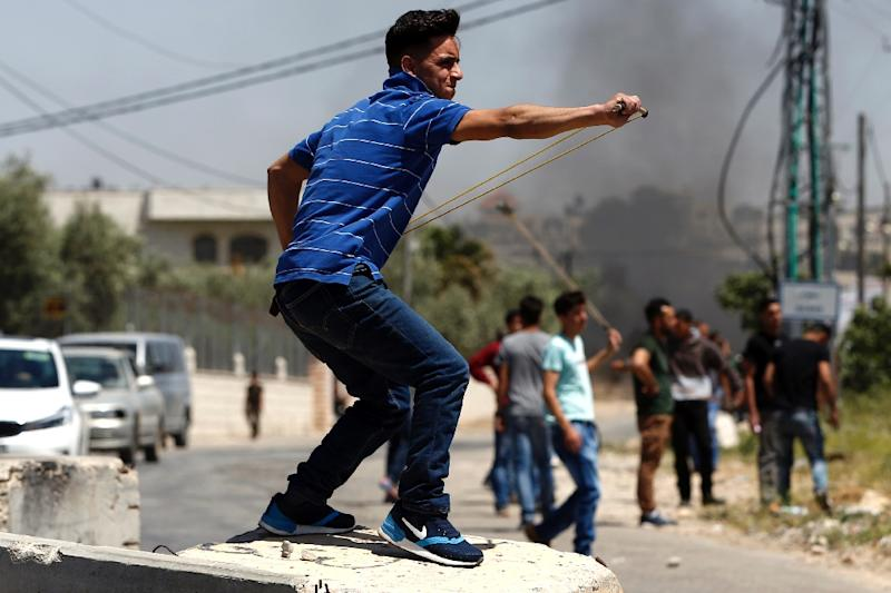 Palestinian protesters clash with Israeli soldiers in the occupied West Bank village of Silwad during a demonstration in support of hundreds of Palestinian prisoners on hunger strike in Israeli jails (AFP Photo/ABBAS MOMANI)