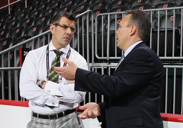 NEWARK, NJ - JUNE 30: (L-R) Executive Vice President and General Manager Marc Bergevin of the Montreal Canadiens speaks with Executive Vice President & General Manager Kevin Cheveldayoff of the Winnipeg Jets during the 2013 NHL Draft at the Prudential Center on June 30, 2013 in Newark, New Jersey. (Photo by Bruce Bennett/Getty Images)