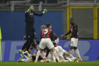 AC Milan players celebrate the third goal against Lazio form their teammate Theo Hernandez during a Serie A soccer match between AC Milan and Lazio, at the San Siro stadium in Milan, Italy, Wednesday, Dec. 23, 2020. (AP Photo/Luca Bruno)