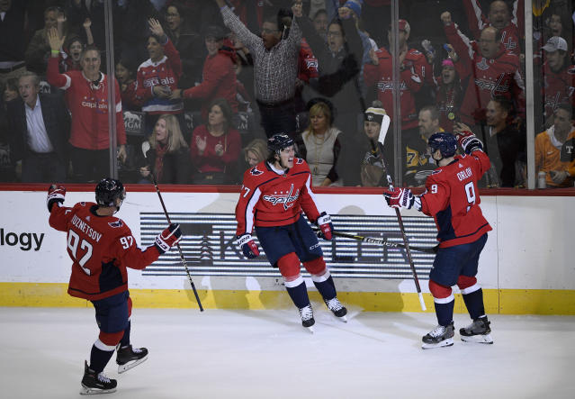 Washington Capitals right wing T.J. Oshie (77) celebrates his goal with center Evgeny Kuznetsov (92), of Russia, and defenseman Dmitry Orlov (9), of Russia, during the third period of an NHL hockey game against the Pittsburgh Penguins, Wednesday, Nov. 7, 2018, in Washington. The Capitals won 2-1. (AP Photo/Nick Wass)