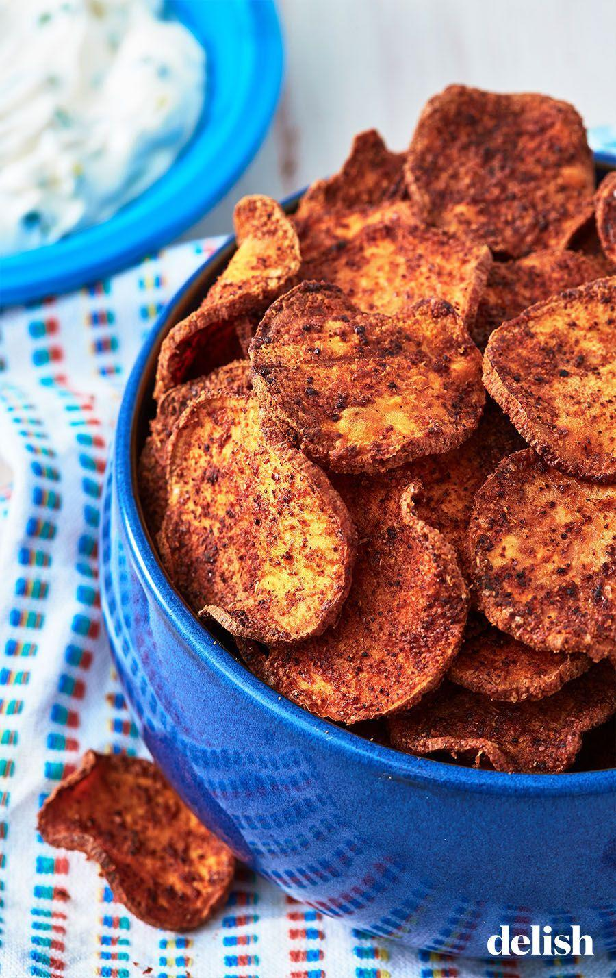 "<p>Homemade chips with a fall twist.</p><p>Get the recipe from <a href=""https://www.delish.com/cooking/recipe-ideas/recipes/a49369/sweet-potato-chips-recipe/"" rel=""nofollow noopener"" target=""_blank"" data-ylk=""slk:Delish"" class=""link rapid-noclick-resp"">Delish</a>.</p>"