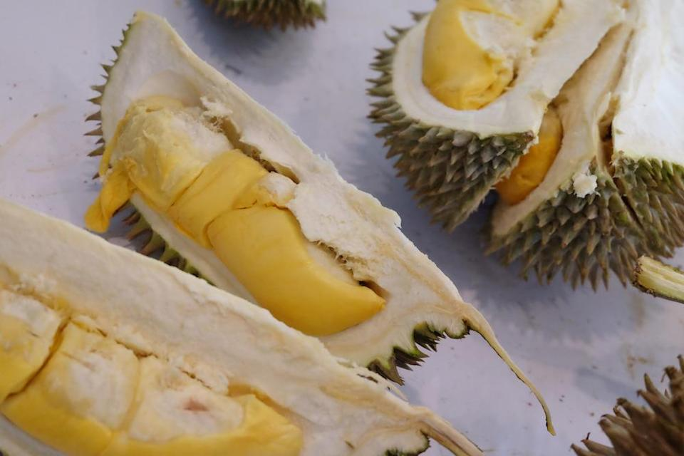 Many of the durian sellers saw a dip in business due to Covid-19 restrictions on cross-district and interstate travel this year. — Picture by Steven Ooi KE