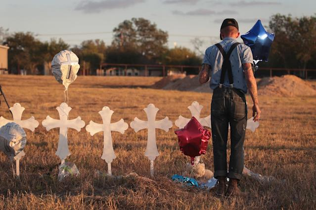 <p>Derrick Bernaden of San Antonio, Texas visits a memorial where 26 crosses stand in a field on the edge of town to honor the 26 victims killed at the First Baptist Church of Sutherland Springs on Nov. 7, 2017 in Sutherland Springs, Texas. (Photo: Scott Olson/Getty Images) </p>