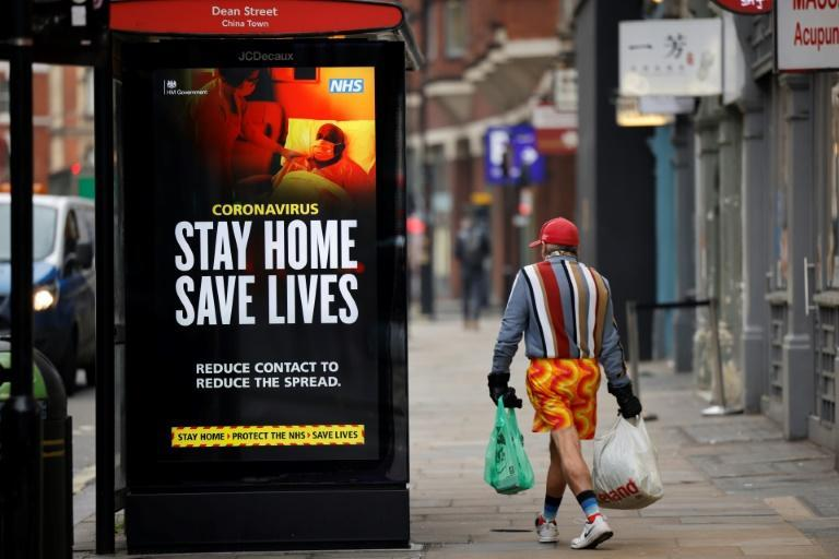 A National Health Srevice poster urges people to stay indoors where they can as the British capital endures a renewed spike in virus cases, driven by the new strain