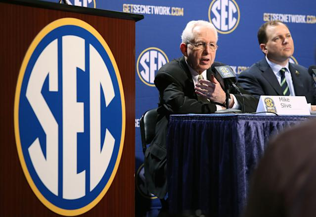 Southeastern Conference Commissioner Mike Slive, left, speaks while sitting next to SEC Network President Justin Connolly during a press conference the day before the SEC Football Championship game at the Georgia Dome, Friday, Dec. 6, 2013, in Atlanta, Ga., (AP Photo/Atlanta Journal-Constitution, Jason Getz)