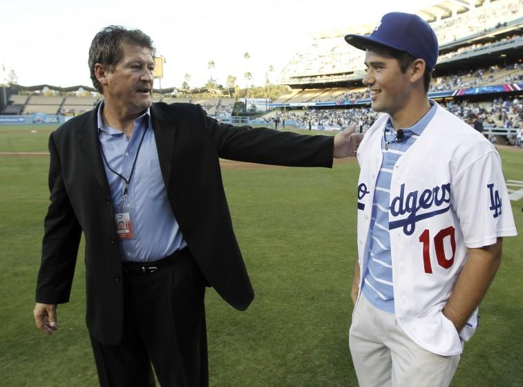 Los Angeles Dodgers assistant general manager Logan White, left, stands with the team's top draft pick, Zach Lee, before the Dodgers' baseball game against the Colorado Rockies in Los Angeles, Wednesday, Aug. 18, 2010. (AP Photo/Chris Carlson)
