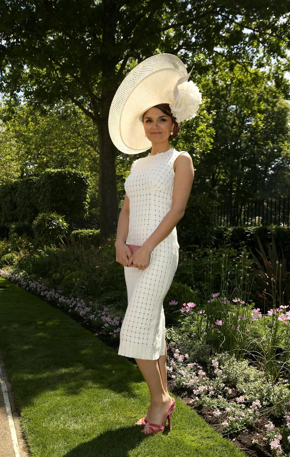 <p>The British actress stood out in 2015 in a huge hat and knitted white dress.<br><i>[Photo: PA]</i> </p>