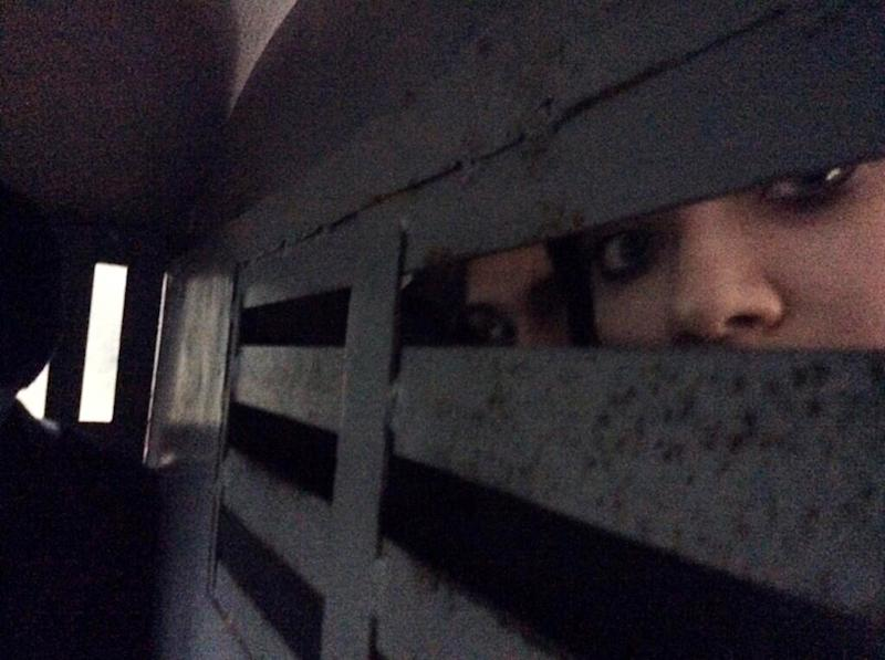 This photo provided by Maria Alekhina, a member of the punk band Pussy Riot, was taken in the back of a police detention vehicle after she and several others were detained in Sochi, Russia, on Tuesday, Feb. 18, 2014. Fellow band member Nadezhda Tolokonnikova wrote on Twitter that she and Alekhina were detained Tuesday while walking in downtown Sochi, the host city of the Winter Olympics. (AP Photo/Maria Alekhina)