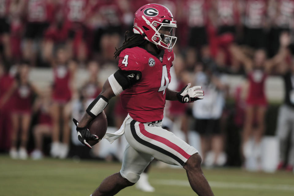Georgia running back James Cook (4) scores against South Carolina during an NCAA college football game Saturday, Sept. 18, 2021, in Athens, Ga. (Joshua Boucher/The State via AP)