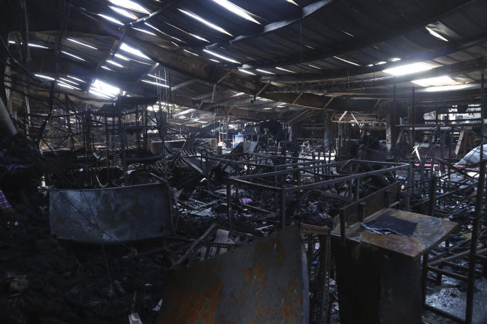 In this Sunday, Feb. 9, 2020 photo, burned remains are seen after a fire broke out at Nandan Denim garment factory, one of the largest denim suppliers in the world, in Ahmedabad, India. At least seven people died in the blaze that swept the factory that has ties to major U.S. retailers, according to its website. Some of the U.S. and multinational companies listed on the website said they were not actually customers, and many issued statements that strongly condemned dangerous work sites. (AP Photo)