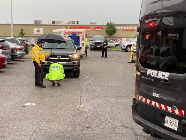 Toronto police's traffic services is investigating after a child was struck by an SUV in a parking lot in Scarborough Saturday evening. (Mark Bochsler/CBC - image credit)