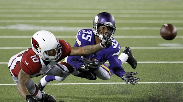 Minnesota Vikings cornerback Marcus Sherels, right, breaks up a pass intended for Arizona Cardinals wide receiver Brittan Golden during the second half of an NFL preseason football game, Saturday, Aug. 16, 2014, in Minneapolis. The Vikings won 30-28. (AP Photo/Ann Heisenfelt)