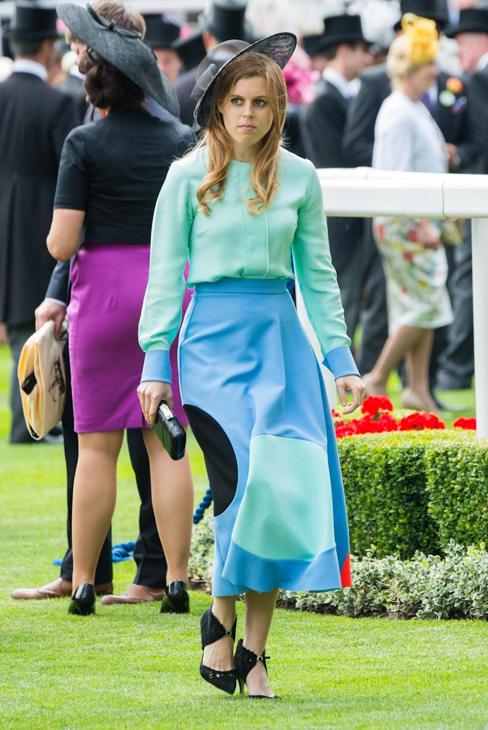 <p>We love this two-tone blue and green number on Princess Eugenie in 2015. <em>[Photo: Getty]</em> </p>
