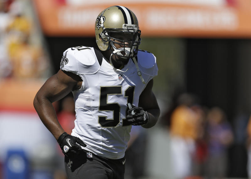 New Orleans Saints linebacker Jonathan Vilma runs off the field after the coin flip before an NFL football game against the Tampa Bay Buccaneers Sunday, Oct. 21, 2012, in Tampa, Fla. (AP Photo/Chris O'Meara)