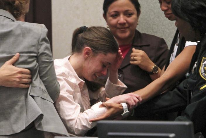 Casey Anthony, center, is overcome with emotion following her acquittal of murder charges at the Orange County Courthouse in Orlando, Fla., Tuesday, July 5, 2011. Anthony had been charged with killing her daughter, Caylee.