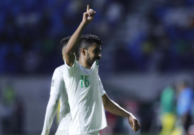 Saudi Arabia's midfielder Hussain Al-Mogahwi, celebrates his goal during the AFC Asian Cup group E soccer match between Lebanon and Saudi Arabia at Al Maktoum Stadium in Dubai, United Arab Emirates, Saturday, Jan. 12, 2019. (AP Photo/Hassan Ammar)