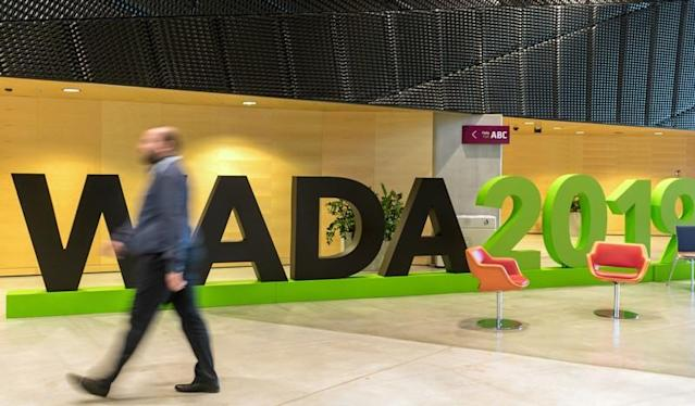 A man walks at the World Anti-Doping Agency (WADA) venue on the eve of the Fifth World Conference on Doping in Sport in Katowice