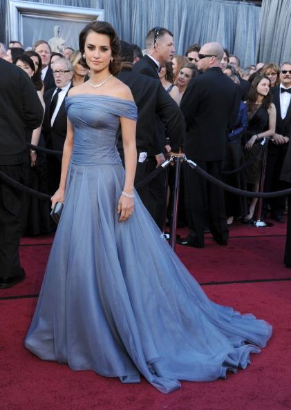 "<div class=""caption-credit""> Photo by: Getty Images</div><div class=""caption-title"">Penélope at the Oscars</div>One of only two <i>Latinas</i> chosen this year by Forbes Magazine as <i>The Best Dressed at the Oscars</i>, Cruz was a red carpet dream in a cornflower blue gown by Armani Prive and delicate Chopard jewels."