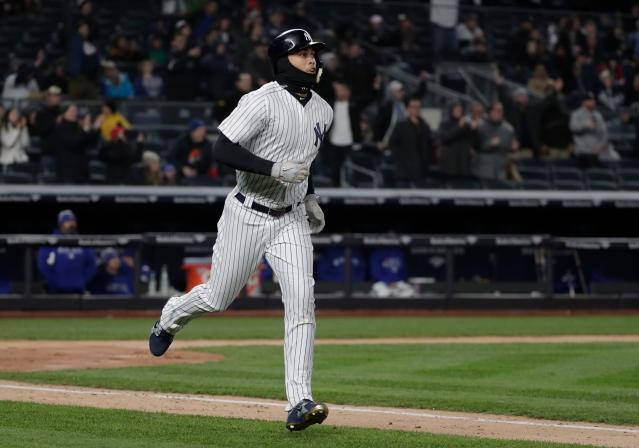 New York Yankees' Giancarlo Stanton heads down the first base line after connecting for a two-run home run against the Toronto Blue Jays during the third inning of a baseball game, Friday, April 20, 2018, in New York. (AP Photo/Julie Jacobson)
