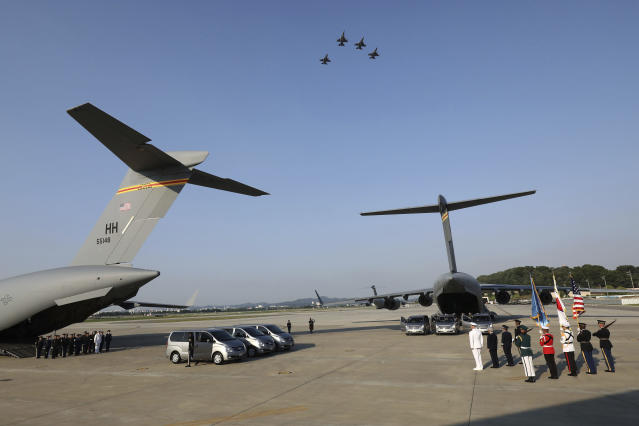 <p>Jets fly in formations overhead as U.N. honor guards carry the remains of U.S. servicemen killed in the Korean War and collected in North Korea, onto an aircraft at the Osan Air Base in Pyeongtaek, South Korea, Wednesday, Aug. 1, 2018. (Photo: Chung Sung-Jun/Pool Photo via AP) </p>
