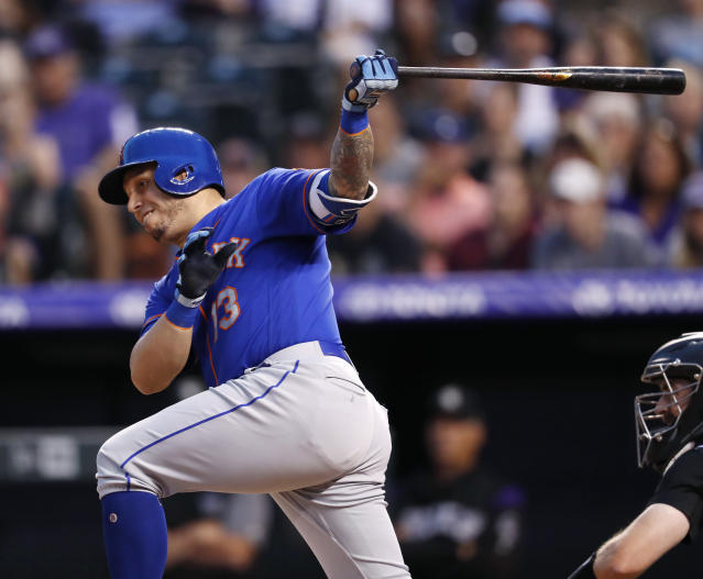 New York Mets' Asdrubal Cabrera watches his two-run single off Colorado Rockies relief pitcher Chris Rusin during the fifth inning of a baseball game Wednesday, June 20, 2018, in Denver. (AP Photo/David Zalubowski)