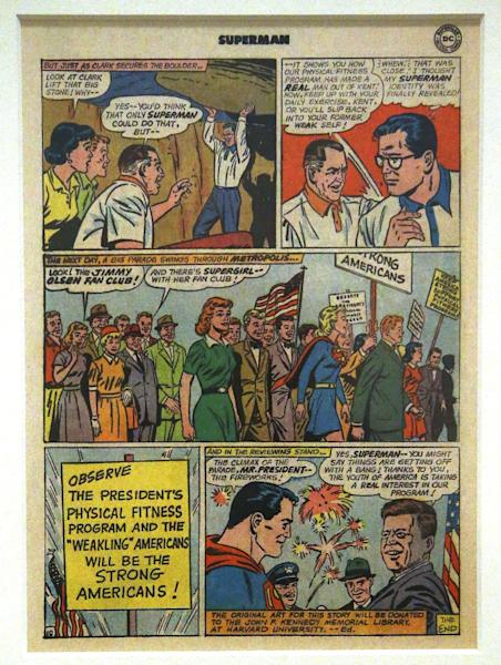 """A page from the 1964 DC comic book """"Superman's Mission for President Kennedy"""" is displayed in a new exhibit at the John F. Kennedy Presidential Library and Museum in Boston, Thursday, March 20, 2014. Each comic book sold carried a message, bottom right, stating """"the original art for this story will be donated to the John F. Kennedy Memorial Library at Harvard University."""" After publication the art went missing until 1993. It was finally donated to the Library in December 2013 by comic book publisher DC Entertainment. (AP Photo/Stephan Savoia)"""