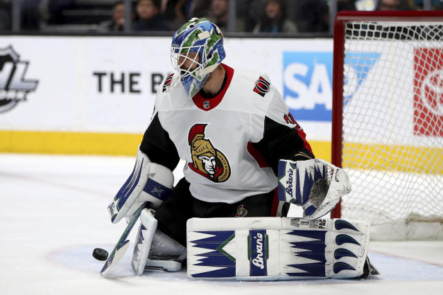 Ottawa Senators goaltender Anders Nilsson stops a shot on goal by the San Jose Sharks during the first period of an NHL hockey game in San Jose, Calif., Saturday, Jan. 12, 2019. (AP Photo/Scot Tucker)